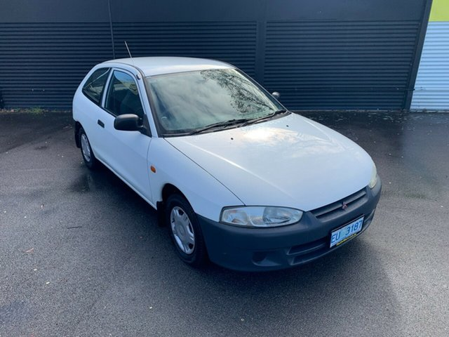 Used Mitsubishi Mirage CE MY2002 Launceston, 2003 Mitsubishi Mirage CE MY2002 White 5 Speed Manual Hatchback
