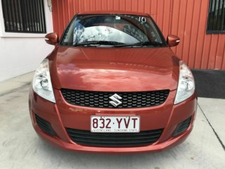 2011 Suzuki Swift FZ GA Orange 5 Speed Manual Hatchback.