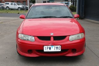 2000 Holden Commodore VX SS Red 4 Speed Automatic Sedan.