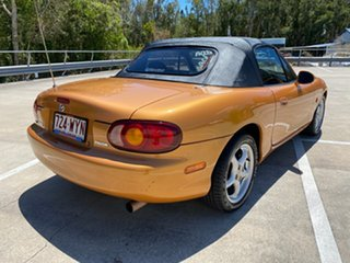 1999 Mazda MX-5 NB Orange 4 Speed Automatic Convertible.