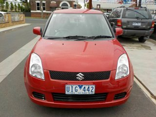 2006 Suzuki Swift EZ Red 5 Speed Manual Hatchback.