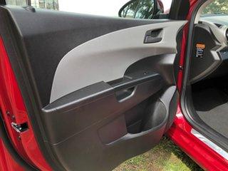 2013 Holden Barina TM MY14 CD Red 5 Speed Manual Hatchback.