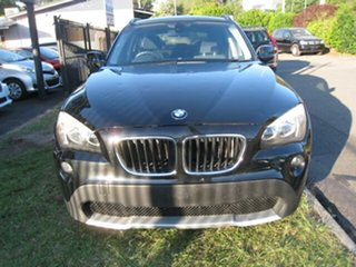2011 BMW X1 E84 MY11 sDrive 18I Black 6 Speed Automatic Wagon.