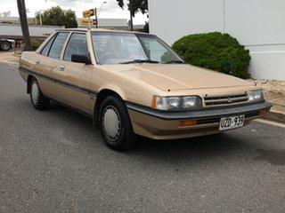 1990 Mitsubishi Magna TP GLX Gold 5 Speed Manual Sedan.