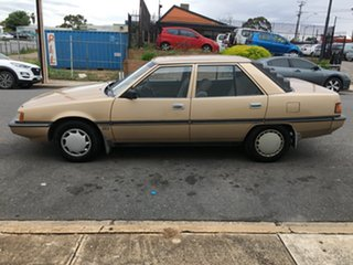 1990 Mitsubishi Magna TP GLX Gold 5 Speed Manual Sedan
