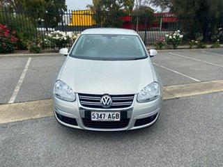 2010 Volkswagen Jetta 1KM MY10 118TSI DSG Silver 7 Speed Sports Automatic Dual Clutch Sedan.