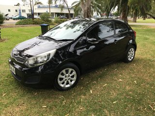 2011 Kia Rio UB MY12 S Black/Grey 4 Speed Sports Automatic Hatchback.