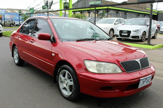 Used Mitsubishi Lancer CE2 MY02.5 GLi West Footscray, 2002 Mitsubishi Lancer CE2 MY02.5 GLi Red 4 Speed Automatic Sedan