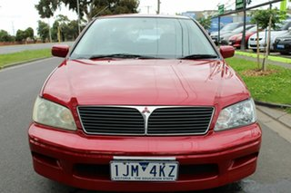 2002 Mitsubishi Lancer CE2 MY02.5 GLi Red 4 Speed Automatic Sedan.