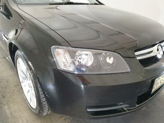 2010 Holden Commodore VE MY10 Omega Black 6 Speed Sports Automatic Sedan.