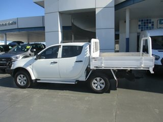 2013 Mitsubishi Triton MN MY14 Update GLX (4x4) White 4 Speed Automatic 4x4 Double Cab Chassis.