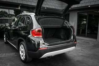 2010 BMW X1 E84 MY11 sDrive18i Steptronic Black 6 Speed Sports Automatic Wagon