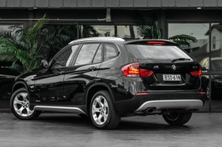 2010 BMW X1 E84 MY11 sDrive18i Steptronic Black 6 Speed Sports Automatic Wagon.