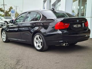 2011 BMW 3 Series 323i Lifestyle Black 6 Speed Automatic Sedan.
