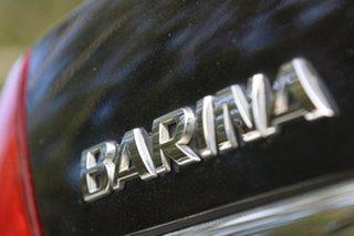 2006 Holden Barina TK MY07 Black 4 Speed Automatic Sedan.