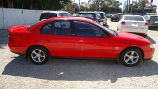 2002 Holden Commodore VX II Acclaim Red 4 Speed Automatic Sedan.