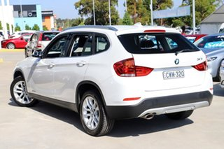 2014 BMW X1 E84 MY0314 sDrive18d White 8 Speed Sports Automatic Wagon.