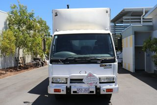2001 Nissan UD White Manual Curtain Sider.