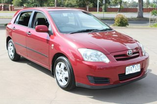 2006 Toyota Corolla ZZE122R MY06 Ascent Seca Maroon 5 Speed Manual Hatchback.
