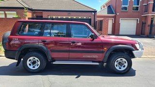 2000 Nissan Patrol GU II ST Burgundy 4 Speed Automatic Wagon.