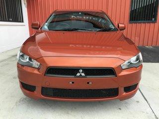 2011 Mitsubishi Lancer CJ MY11 SX Orange 5 Speed Manual Sedan.