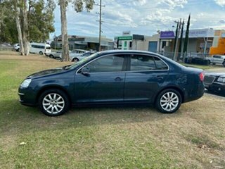 2010 Volkswagen Jetta 1KM MY10 125TDI DSG Highline Blue 6 Speed Sports Automatic Dual Clutch Sedan