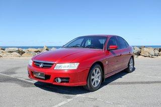 2005 Holden Berlina VZ Red 4 Speed Automatic Sedan.