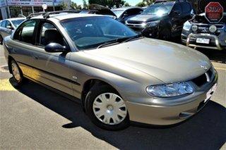 2001 Holden Commodore VX Executive Gold 4 Speed Automatic Sedan.