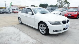 2010 BMW 3 Series E90 MY10 323i Steptronic White 6 Speed Sports Automatic Sedan.