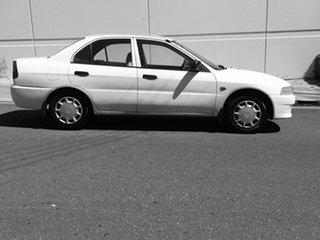 2000 Mitsubishi Lancer CE2 GLXi White 5 Speed Manual Sedan.