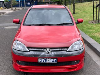 2003 Holden Barina XC MY03 SRi Red 5 Speed Manual Hatchback.