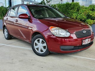 2006 Hyundai Accent Red 4 Speed Automatic Sedan.