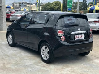 2013 Holden Barina TM MY14 CD Black 6 Speed Automatic Hatchback.