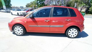 2007 Ford Fiesta WQ Ghia Orange 5 Speed Manual Hatchback