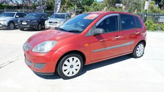 2007 Ford Fiesta WQ Ghia Orange 5 Speed Manual Hatchback.