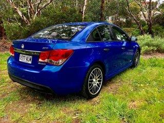2011 Holden Cruze JH Series II MY12 SRi Karma Blue/blue 6 Speed Manual Sedan.