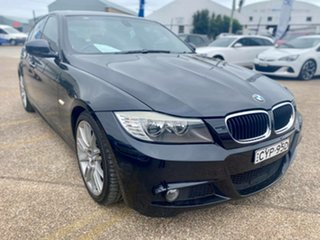 2009 BMW 3 Series E90 MY09 320d Steptronic Executive Black 6 Speed Sports Automatic Sedan.