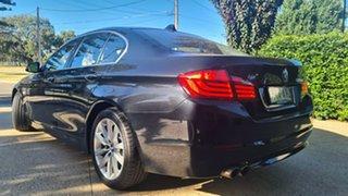 2010 BMW 5 Series F10 MY11 528i Steptronic Black Sapphire 8 Speed Sports Automatic Sedan.
