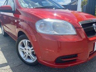 2009 Holden Barina TK MY09 Red 4 Speed Automatic Sedan.