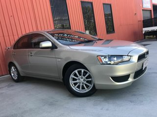 2010 Mitsubishi Lancer CJ MY11 SX Gold 5 Speed Manual Sedan.