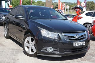 2010 Holden Cruze JG CDX Black 6 Speed Sports Automatic Sedan.