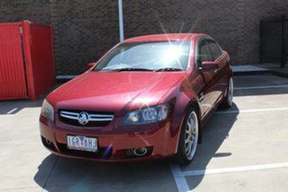 2008 Holden Berlina VE MY08 Dual Fuel Red 4 Speed Automatic Sedan.