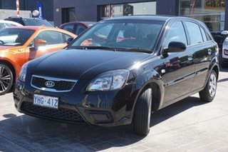 2010 Kia Rio JB MY10 S Black 4 Speed Automatic Hatchback.