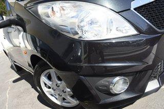 2011 Holden Barina Spark MJ MY11 CD Black 5 Speed Manual Hatchback.