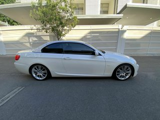 2010 BMW 3 Series E93 MY10.5 320d Steptronic White 6 Speed Sports Automatic Convertible.