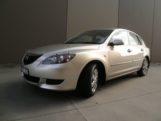 2004 Mazda 3 BK10F1 Neo Champagne Beige 5 Speed Manual Hatchback.