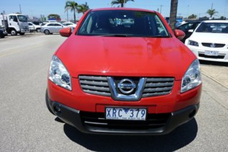 2009 Nissan Dualis J10 MY2009 Ti AWD Flame Red 6 Speed Manual Hatchback.