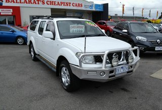 2010 Nissan Navara D40 ST (4x4) White 6 Speed Manual Dual Cab Pick-up.