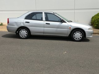 2000 Mitsubishi Lancer CE2 GLi White 4 Speed Automatic Sedan.