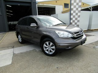 2012 Honda CR-V RE MY2011 4WD Grey 6 Speed Manual Wagon.